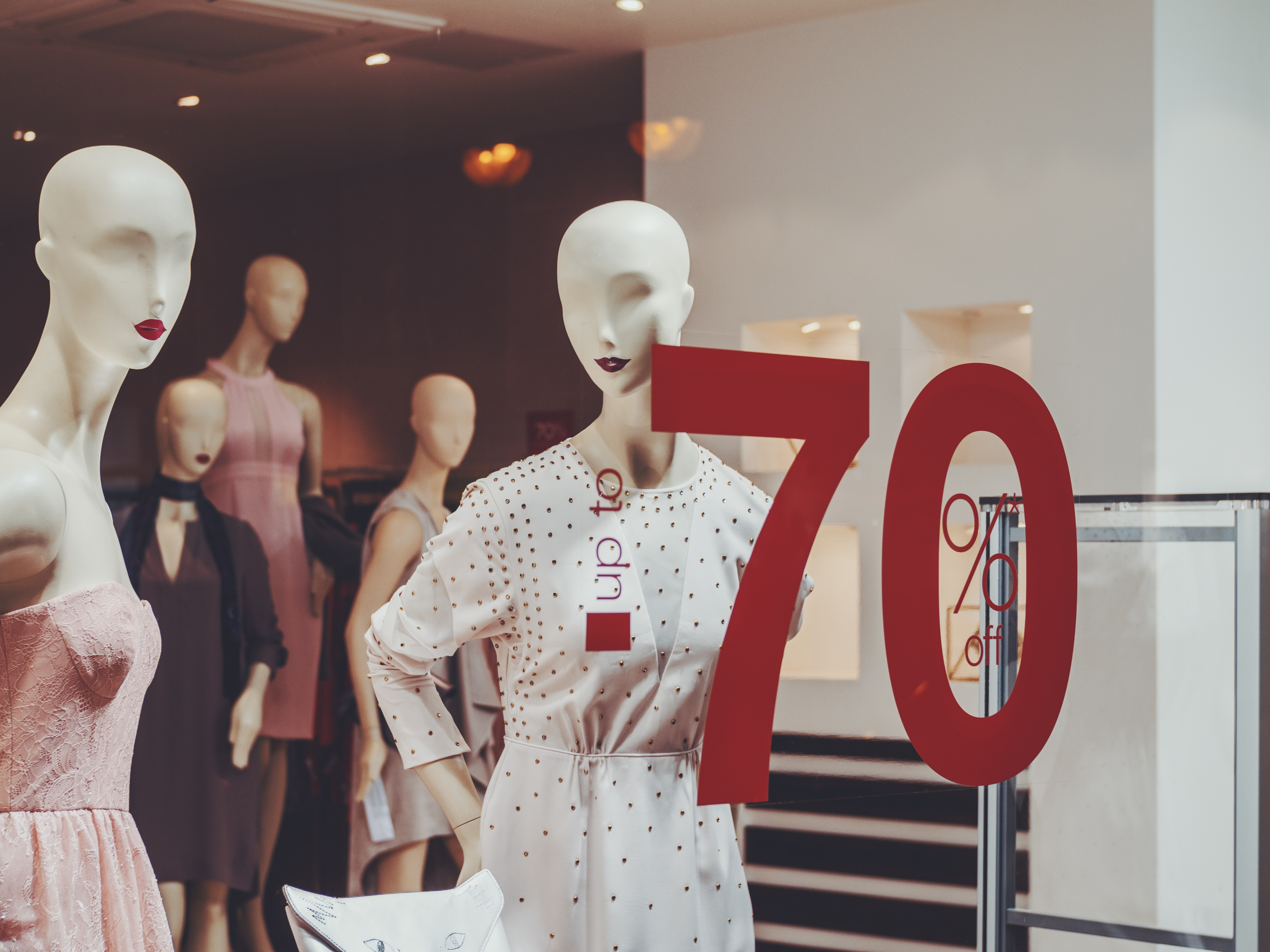 Store window design with 70% written on the glass for shopping.
