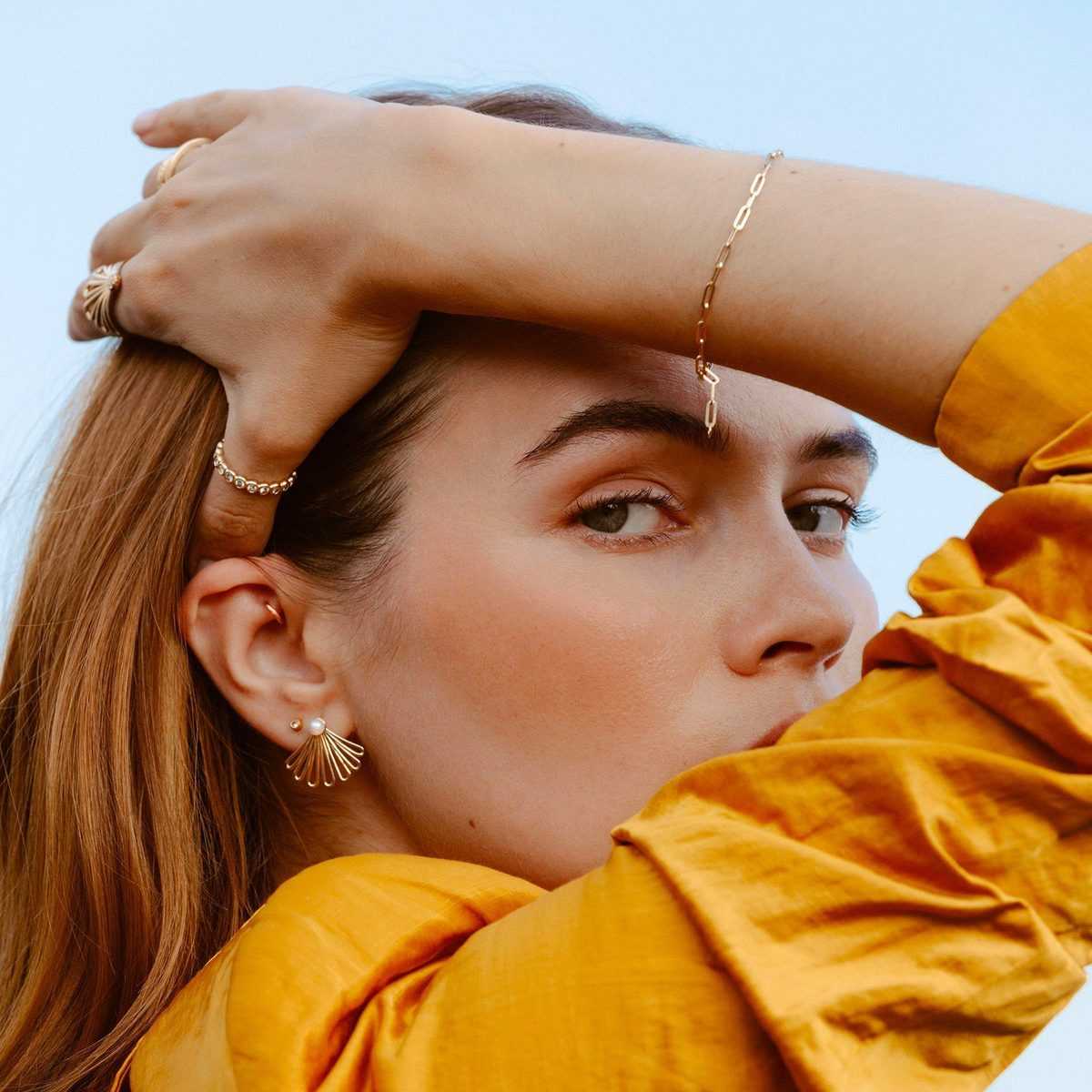 Model showing off jewelry from ethical fashion brand, Au-Rate.