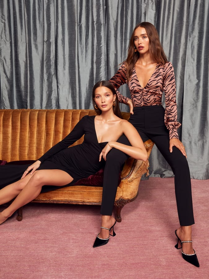 Two models posing in clothes from ethical fashion brand, Reformation.